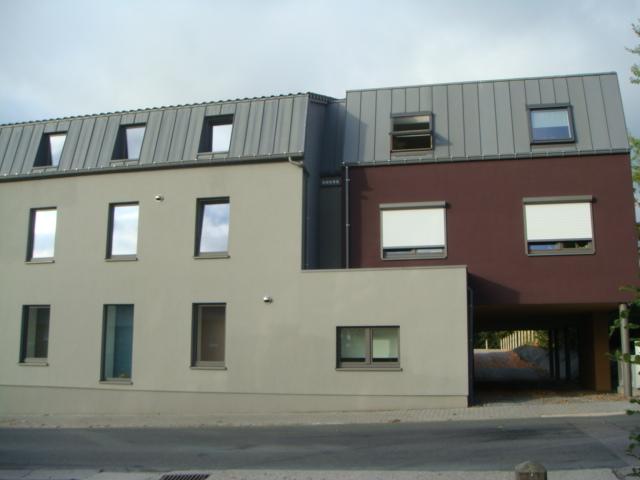 Transformation d'une habitation en immeuble de 5 appartements à Montzen