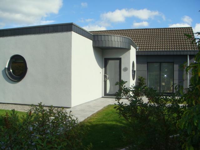 Agrandissement et relooking d'une habitation existante à Henri-Chapelle